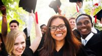 Diverse group of graduating students in cap and gown