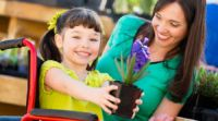 A mother and daughter at a garden center.